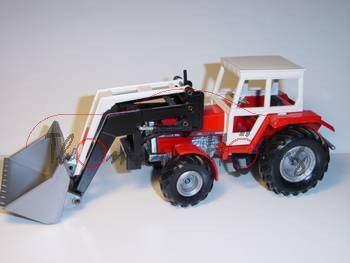Massey Ferguson 3050 A Traktor mit Schaufellader, rot, m-